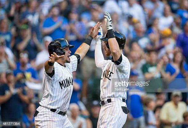 Gerardo Parra of the Milwaukee Brewers greets teammate Jonathan Lucroy after Lucroy hit a tworun home run off of Vance Worley of the Pittsburgh...