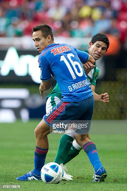 Gerardo Rodriguez of Chivas fights for the ball with Jonny Magallon of Leon during a match between Chivas and Leon as part of the round 11th of...