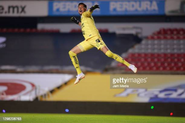 Gerardo Ruiz, goalkeeper of Queretaro, celebrates after the first goal of his team during the 3rd round match between Queretaro and Pumas UNAM as...