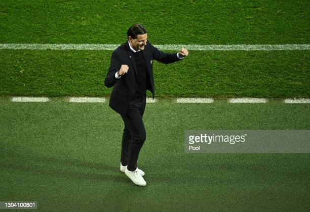 Gerardo Seoane, Head Coach of BSC Young Boys celebrates following his team's victory in the UEFA Europa League Round of 32 match between Bayer...