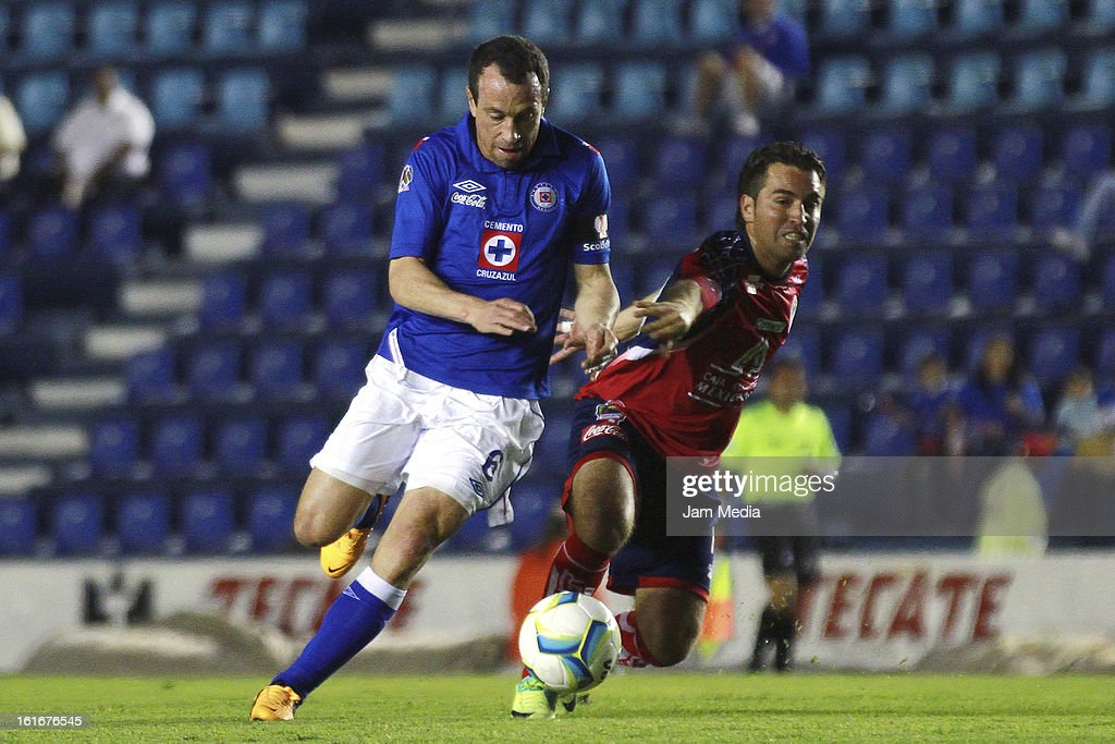 Gerardo Torrado (L) of Cruz Azul struggles for the ball with Carlos Balcazar (R) of Irapuato during a match between Cruz Azul and Irapuato as part of the Clausura 2013 Copa MX at Azul Stadium on february 13, 2013 in Mexico City, Mexico.