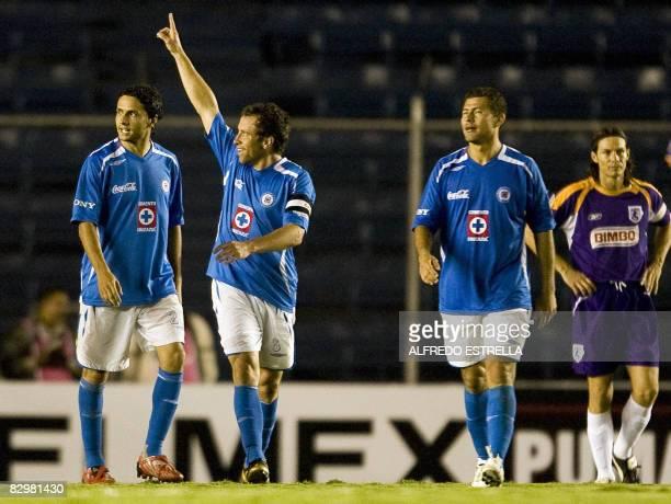 Gerardo Torrado of Mexico's Cruz Azul celebrates his goal against the Saprissa of Costa Rica during a Concacaf Champions Cup football match on...