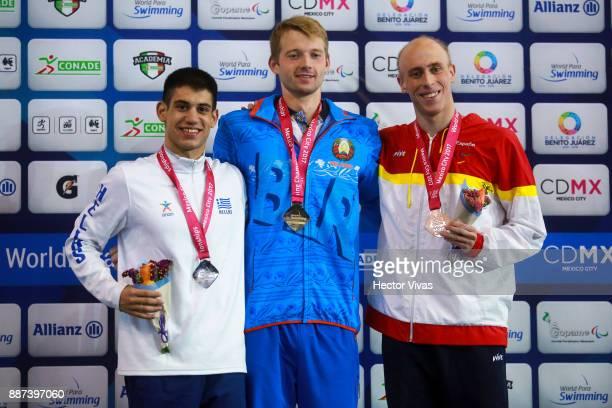 Gerasimos Lignos of Greece Ihar Boki of Belarus and Ivan Salguero of Spain pose after the Men's 200m Indiv Medley SM13 Final during day 5 of the Para...