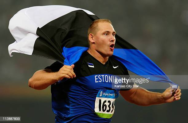 Gerd Kanter of Estonia celebrates his gold medal in the discus on Tuesday August 19 in the Games of the the XXIX Olympiad in Beijing China