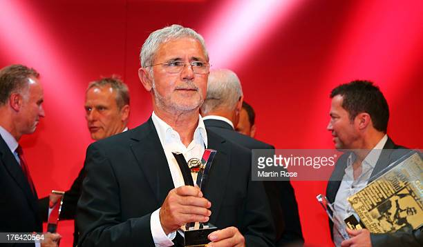 Gerd Mueller poses with the Sport Bild Award during the Sport Bild Awards at Fischauktionshalle on August 12 2013 in Hamburg Germany