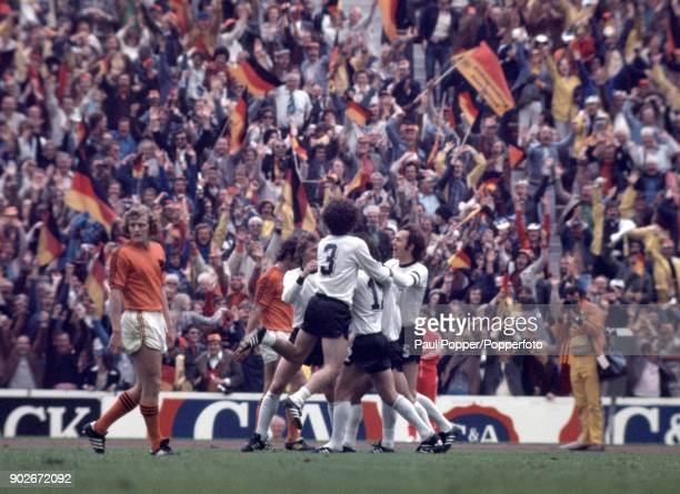 Gerd Muller is surrounded by his teammates after scoring the winning goal for West Germany during the FIFA World Cup Final between West Germany and...