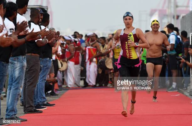 Gerda Maria Dumitru competes during the Ironman 703 World Championship event in Colombo on February 25 2018 The Ironman 703 Colombo event involved a...