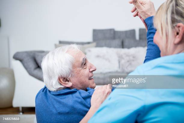 gereatric nurse doing physio therapy with patient - outpatient care stock pictures, royalty-free photos & images