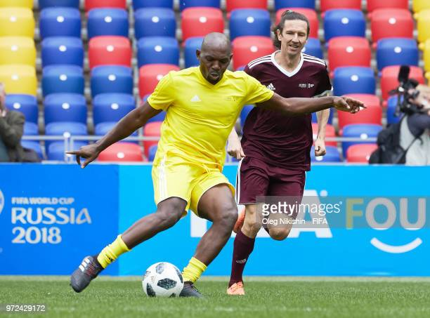 Geremi Njitab of CAF vies for the ball with Alexey Smertin of Russian FA during FIFA Congress Delegation Football Tournament at Arena CSKA stadium on...