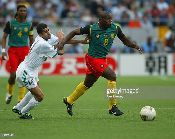 Geremi of Cameroon takes the ball past Abdulaziz al Khathran of Saudi Arabia during the FIFA World Cup Finals 2002 Group E match played at the...