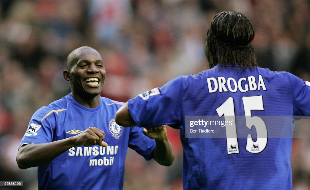 Geremi (L) of Chelsea is congratulated by Didier Drogba after scoring the fourth goal of the game during the Barclays Premiership match between Liverpool and Chelsea at Anfield on October 2, 2005 in Liverpool, England.
