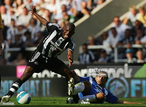 Geremi of Newcastle is tackled by Josip Skoko of Wigan during the Barclays Premier League match between Newcastle United and Wigan Athletic at...