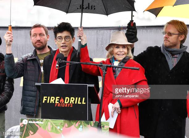 Gerett Rappenhagen Manny Jacinto and Jane Fonda demonstrate near the US Capitol during Fire Drill Friday climate change protest on November 22 2019...