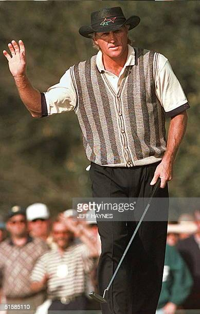 Gerg Norman of Australia waves to the crowd after making birdie on the seventeenth hole during the opening round of The Masters 11 April at the...