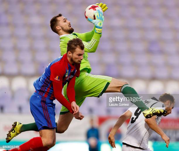 Gergely Nagy of Vasas FC catches the ball between Vit Benes of Vasas FC and Marton Eppel of Budapest Honved during the Hungarian OTP Bank Liga match...