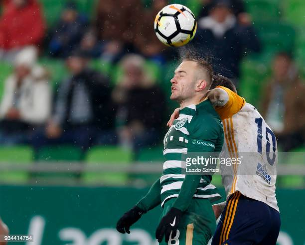 Gergo Lovrencsics of Ferencvarosi TC battles for the ball in the air with Andras Rado of Puskas Akademia FC during the Hungarian OTP Bank Liga match...