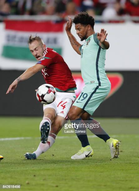 Gergo Lovrencsics of Hungary and Eliseu of Portugal in action during the FIFA 2018 World Cup Qualifier match between Hungary and Portugal at Groupama...