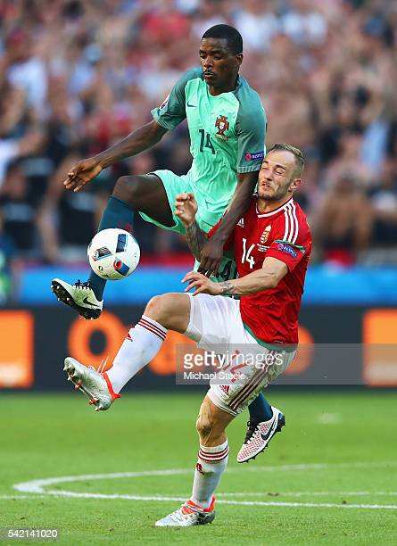Gergo Lovrencsics of Hungary and William Carvalho of Portugal compete for the ball during the UEFA EURO 2016 Group F match between Hungary and...
