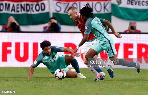 Gergo Lovrencsics of Hungary competes for the ball with Gelson Martins of Portugal before Eliseu of Portugal during the FIFA 2018 World Cup Qualifier...