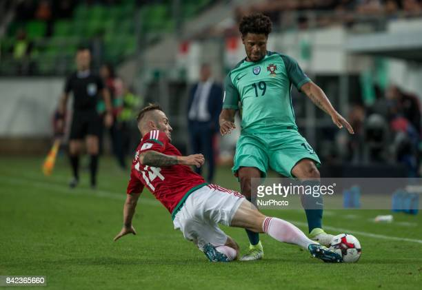 Gergo Lovrencsics of Hungary in action with Eliseu of Portugal during the World Cup qualification match between Hungary and Portugal at Groupama...