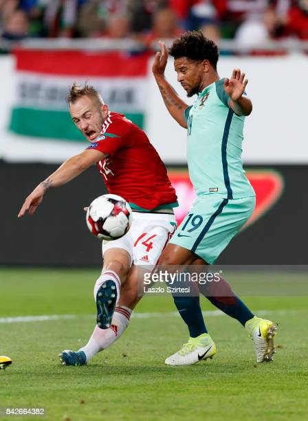 Gergo Lovrencsics of Hungary shoots on goal beside Eliseu of Portugal during the FIFA 2018 World Cup Qualifier match between Hungary and Portugal at...
