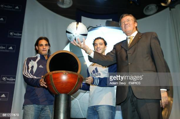 Gerhard Aigner reveals the new Adidas Football for Euro 2004 watched by players Nuno Gomes and Simao Sabrosa