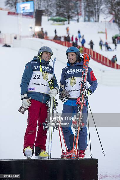 Gerhard Berger and Benjamin Raich pose for a picture during the victory ceremony of the KitzCharityTrophy on January 21 2017 in Kitzbuehel Austria