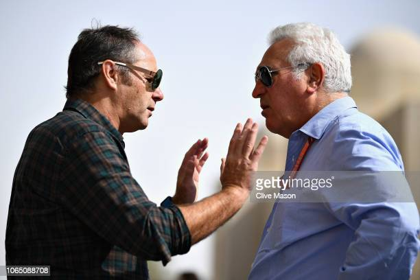 Gerhard Berger and Lawrence Stroll talk in the Paddock before the Abu Dhabi Formula One Grand Prix at Yas Marina Circuit on November 25 2018 in Abu...
