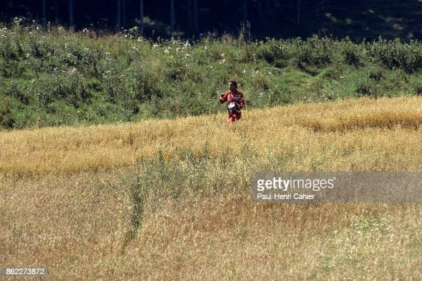 Gerhard Berger Grand Prix of Austria Osterreichring 16 August 1987 Gerhard Berger walking through the fields on his way back to the pits after...