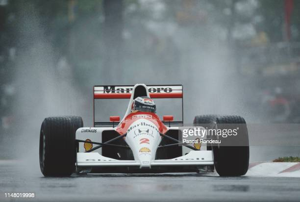 Gerhard Berger of Austria drives the Honda Marlboro McLaren MP4/6 Honda RA121E V12 in the rain during the San Marino Grand Prix on 28 April 1991 at...