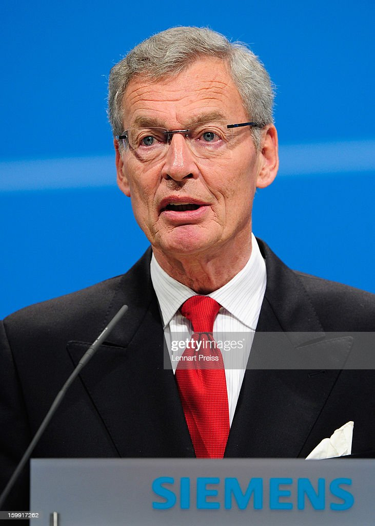 Gerhard Cromme (L), chairman of the supervisory board of Siemens AG, speaks to the shareholders during the Siemens annual general shareholder's meeting at the Olympiahalle on January 23, 2013 in Munich, Germany. Siemens announced that although the new orders declined slightly year-over-year, the book-to-bill ratio was again above 1 for the first time in three quarters. Total Sectors profit rose some four percent.