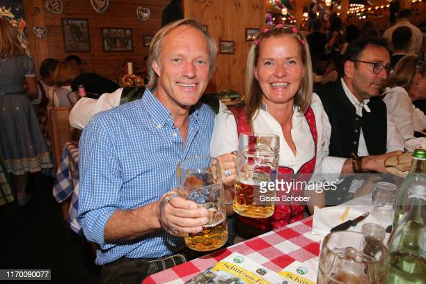Gerhard Delling and his partner Vicki Hinrichs during the Oktoberfest 2019 opening at Theresienwiese on September 21 2019 in Munich Germany