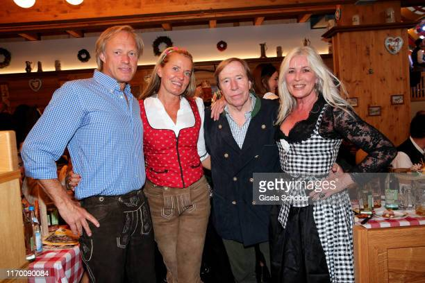 Gerhard Delling and his partner Vicki Hinrichs Guenter Netzer and his wife Elvira Lang Netzer during the Oktoberfest 2019 opening at Theresienwiese...