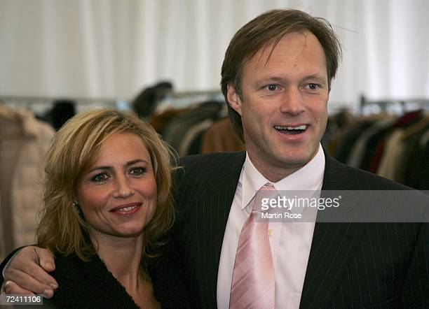Gerhard Delling and his wife Isabelle pose during the birthday party of German soccer legend Uwe Seeler at the AOL Arena on November 5 2006 in...