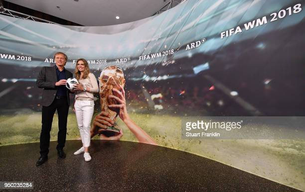 Gerhard Delling and Julia Scharf pose for a picture during the ARD and ZDF FIFA World Cup presenter team presentation on April 23 2018 in Hamburg...