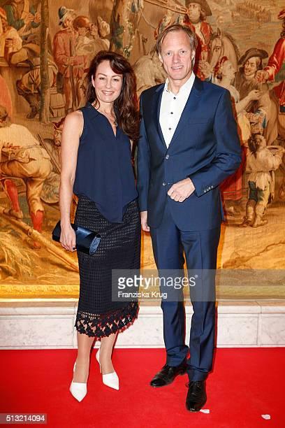 Gerhard Delling and Sabrina Staubitz attend the Soiree Hotel Vier Jahreszeiten on March 01 2016 in Hamburg Germany
