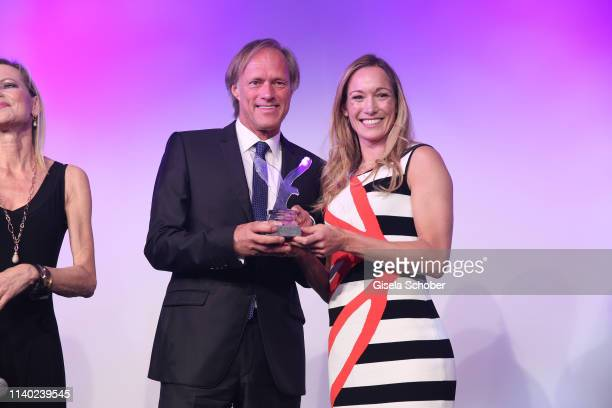 Gerhard Delling Dr Christine Theiss during the 7th Fashion Charity Dinner and the Best of Awards at Hotel Leonardo Royal on April 29 2019 in Munich...