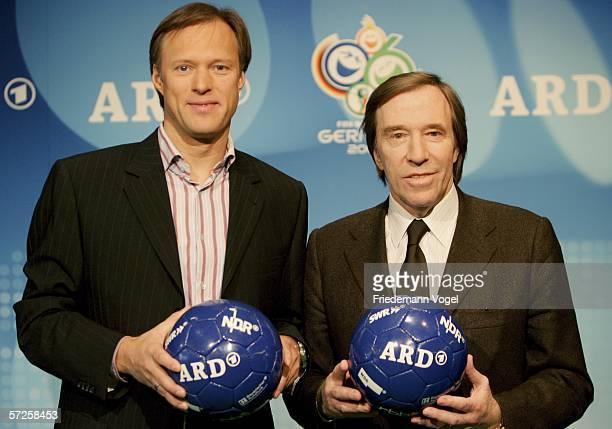 Gerhard Delling moderator and Guenter Netzer expert of ARD pose for the media before a press conference with German TV channels ARD and ZDF at the...