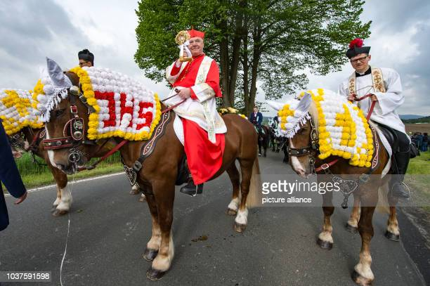 Gerhard Ludwig Mueller CurialCardinal and prefect of the Congregation for the Doctrine of the Faith rides his horse in the Koetzing Pentecost Ride...