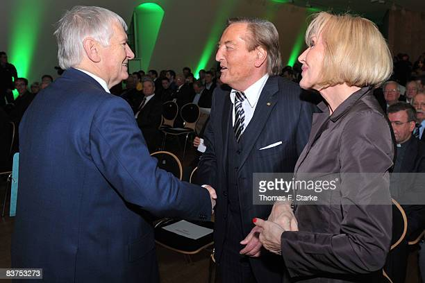 Gerhard MayerVorfelder current Vice President of the Union of European Football Associations and his wife Margit shake hands with jury member and...
