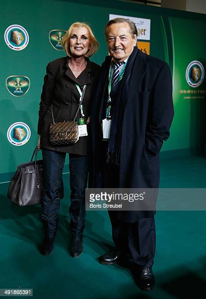 Gerhard MayerVorfelder pose with his wife Margit on the green carpet prior to the DFB Cup final at Olympiastadion on May 17 2014 in Berlin Germany