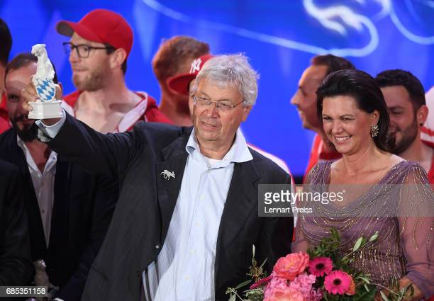 Gerhard Polt, winner of the Honorary Award, poses with his award next to Bavarian state minister Ilse Aigner during the Bayerischer Fernsehpreis 2017...