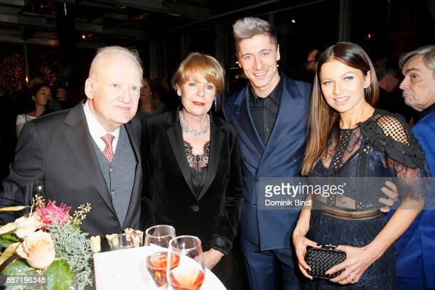 Gerhard Rueschenbeck and his wife pictured with Robert Lewandowski and his wife Anna Lewandowska attend the Rueschenbeck and BUNTE reception at Hotel...