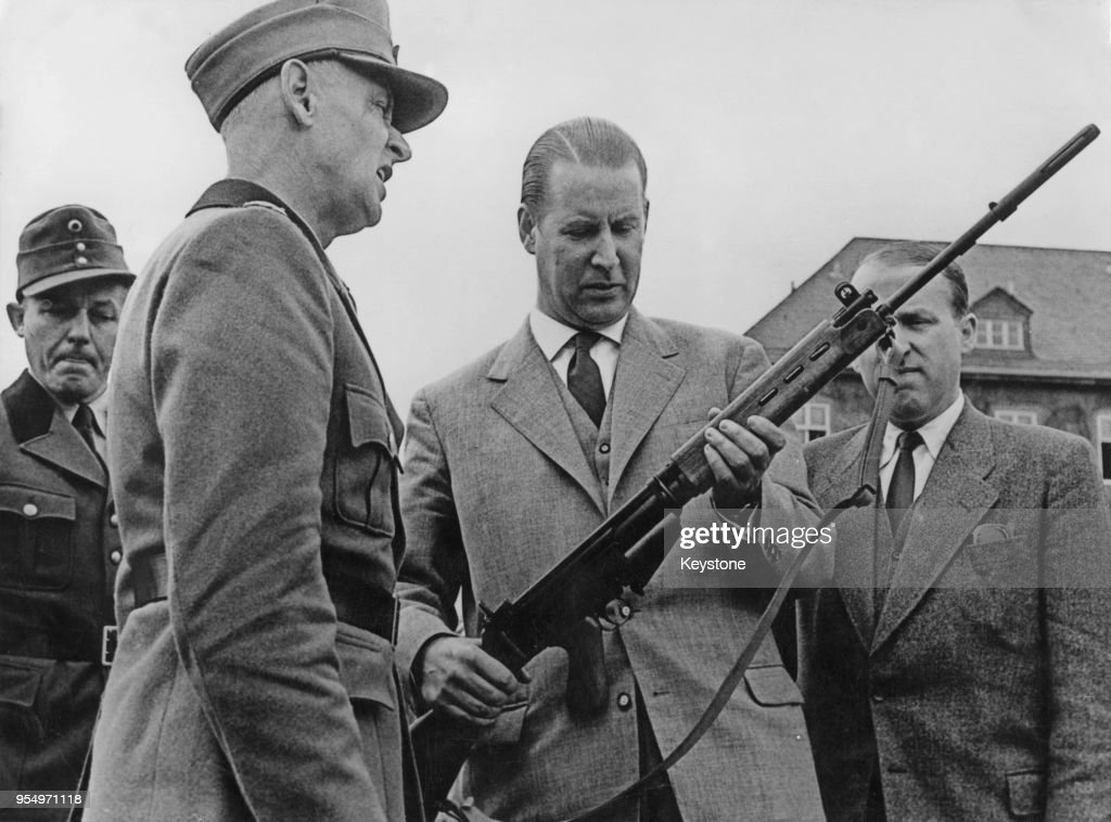 Gerhard Schröder (1910 - 1989), the German Minister of the Interior, inspects the new Belgian rifle issued to the newly-formed German Frontier Units, 30th July 1956.
