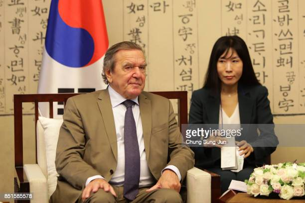 Gerhard Schroeder and South Korean National Assembly Speaker Chung Syekyun attend a meeting at the National Assembly on September 11 2017 in Seoul...