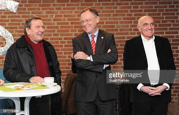 Gerhard Schroeder curator of the Bundesliga charity Stephan Weil mayor of Hanover and Martin Kind chairman of Hannover 96 attend the presentation of...