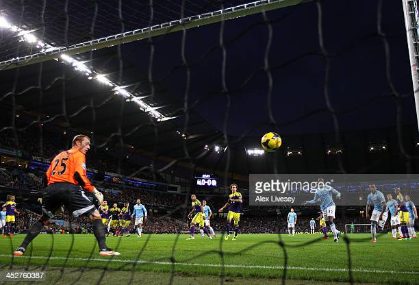 Gerhard Tremmel of Swansea City can only watch as the free kick from Alvaro Negredo of Manchester City beats him for the opening goal during the...