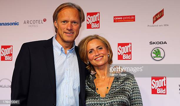 Gerhard und Isabelle Delling pose for the media before the Sport Bild Awards at Fischauktionshalle on August 12 2013 in Hamburg Germany