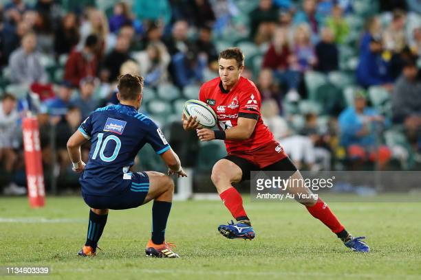 Gerhard van den Heever of the Sunwolves makes a run at Harry Plummer of the Blues during the round 4 Super Rugby match between the Blues and the...