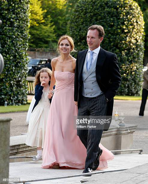 Geri Halliwell and Bluebell Halliwell seen at Poppy Delevingnes wedding held in Kensington Palace Gardens on May 16 2014 in London England